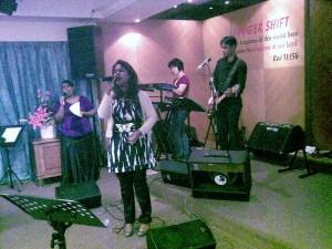 Joanne Jayarathnam leading worship