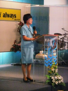 Mrs Ang teaching at T Net before the Service