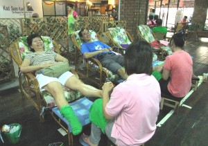 enjoying a foot massage after shopping