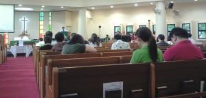 Pastor Richard Seow leading the prayers