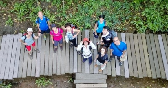 Looking down at friends from the tower at Chek Jawa
