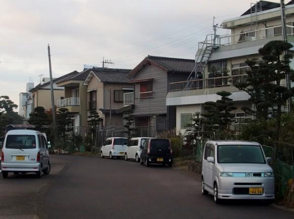 Terrace houses and boxy passenger vans