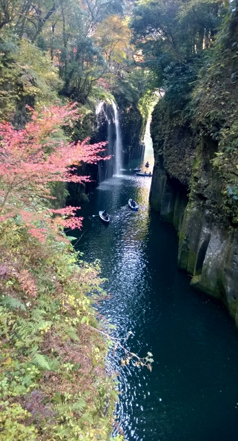 Beautiful autumn branches frame the cool deep waters and waterfall.