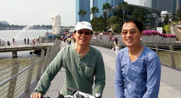 On a bridge with the Merlion behind