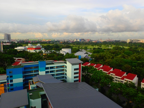 Jurong Country Club and Science Centre and the green belt beyond the foreground of a school.
