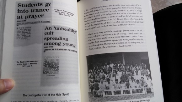 The book with photographs of the newspaper stories of speaking in tongues among students and several WRPF photos is inside