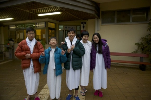 After baptism the parents quickly put on jackets on their kids except one kid