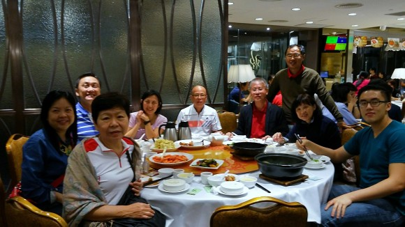 Church folks in the hiking group have dinner with the Chong family and Vincent.