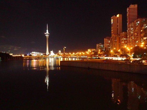 Macau by night with the tower standing like a shining needle